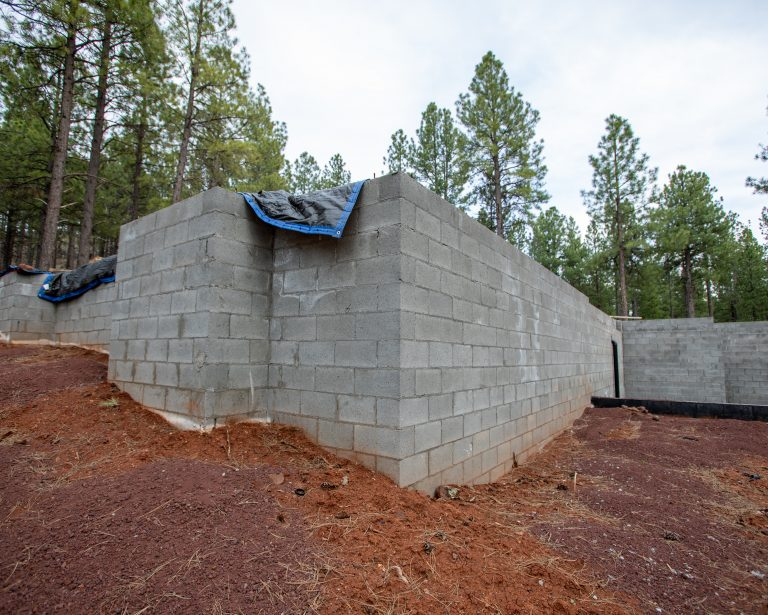 photo of a foundation in red dirt at a golf course home in flagstaff